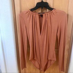 Brand new orange long sleeve bodysuit